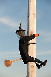 Halloween decoration of a witch on a pole