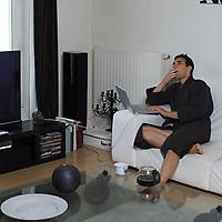 portrait of man in bathrobe drinking his coffee jar