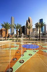 Sunny day at the Downtown Aquarium fountain with the Houston skyline in the background.