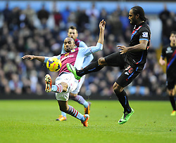 Aston Villa's Fabian Delph battles for the ball with Crystal Palace's Cameron Jerome - Photo mandatory by-line: Joe Meredith/JMP - Tel: Mobile: 07966 386802 26/12/2013 - SPORT - FOOTBALL - Villa Park - Birmingham - Aston Villa v Crystal Palace - Barclays Premier League