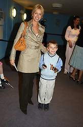 CAROLINE HABIB and her godson GABRIELLE ELMS at a performance by the London Childrens Ballet of 'The Little Princess' at The Peacock Theatre, Portugal Street, London WC2 on 19th May 2005.<br />