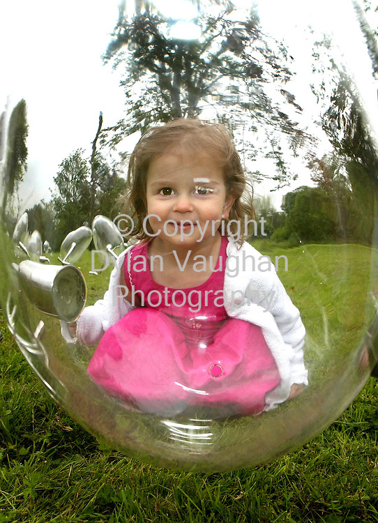 "6/7/2002 Irish Examiner News.Free Picture No Charge.Pictured at the opening of The International Glass Art Festival ""Artist in Glass"" in Waterford was Isobel Strudwick aged 2 with some work by Belgian Artist Koen Vanmechelem called "" Walking Eggs 2001"".Picture Dylan Vaughan"