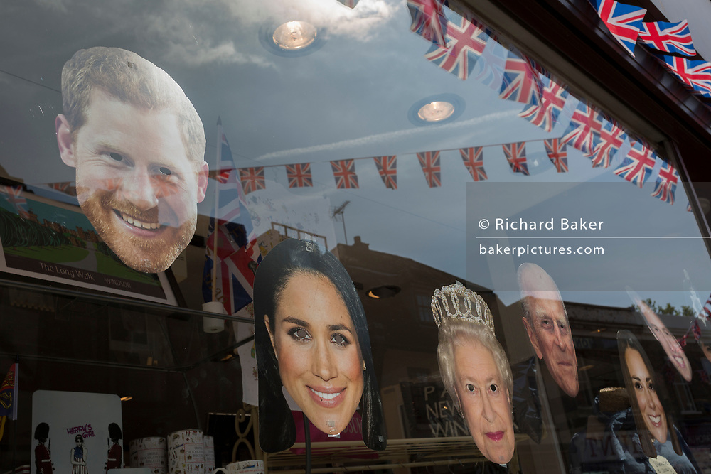 Face masks of the royal family in a shop window as the royal town of Windsor gets ready for the royal wedding between Prince Harry and his American fiance Meghan Markle, on 14th May 2018, in London, England. (Photo by Richard Baker / In Pictures via Getty Images)