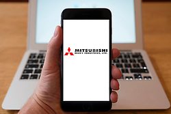 Using iPhone smartphone to display logo of Mitsubishi Heavy Industries