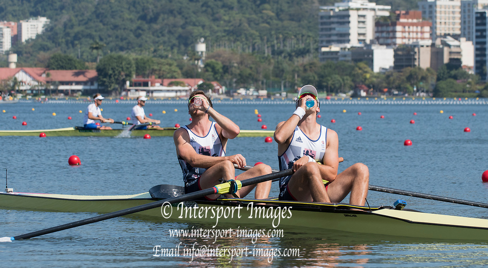 Rio de Janeiro. BRAZIL.   2016 GBR M2- bow Alan SINCLAIR and Stewart INNES,  CAMPBELL , taking a drink before the start of there heat  at the Olympic Rowing Regatta. Lagoa Stadium,<br /> Copacabana,  &ldquo;Olympic Summer Games&rdquo;<br /> Rodrigo de Freitas Lagoon, Lagoa. Saturday  06/08/2016 <br /> <br /> [Mandatory Credit; Peter SPURRIER/Intersport Images]