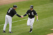 CHICAGO - MAY 21:  Brent Lillibridge #18 is greeted by third base coach Jeff Cox #8 of the Chicago White Sox after hitting a home run during the game against the Los Angeles Dodgers on May 21, 2011 at U.S. Cellular Field in Chicago, Illinois.  The White Sox defeated the Dodgers 9-2.  (Photo by Ron Vesely)  Subject:   Brent Lillibridge;Jeff Cox