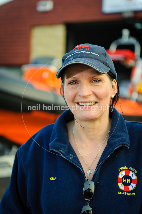 Hornsea Inshore Rescue, pictured Sue Hickson-Marsay. She's  the chairman and one of the coxswain's of Hornsea's independent lifeboat. Sue's day job is skippering a Humber pilot boat at spurn point. The lifeboat in the picture is brand new and was delivered on the day of the photo shoot 25th March 2011.