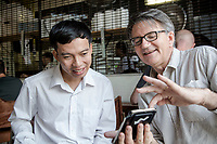 Photographer Michael Amendolia and Tran Van Giap meet in a cafe in Sydney's inner suburbs March 2017.