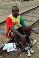 Ghana, Accra, 2007. Ike Marbell in his Independence Day best before an early morning soccer game in Kokomlemle.