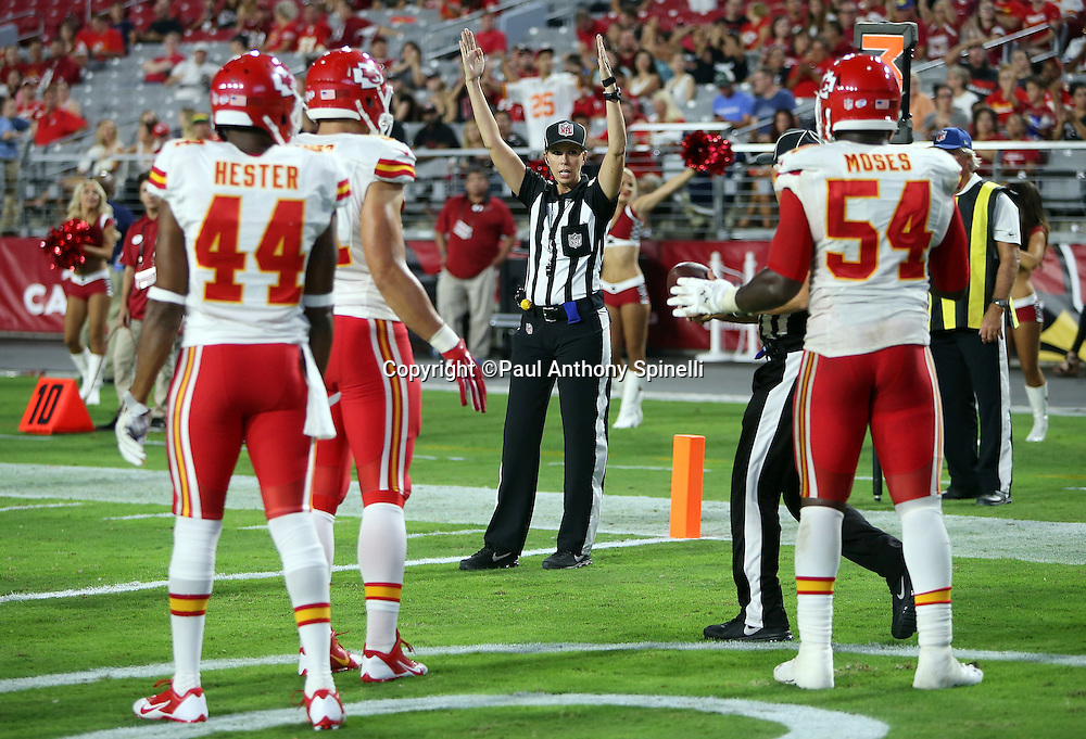 Kansas City Chiefs defenders look on as NFL line judge Sarah Thomas, the first female official in the NFL, signals touchdown after Arizona Cardinals wide receiver Travis Harvey (19) catches a fourth quarter touchdown pass that cuts the Kansas City Chiefs lead to 34-19 during the 2015 NFL preseason football game against the Kansas City Chiefs on Saturday, Aug. 15, 2015 in Glendale, Ariz. The Chiefs won the game 34-19. (©Paul Anthony Spinelli)