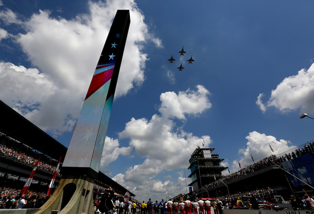 Jets fly over the Indianapolis Motor Speedway following the National Anthem before the start of the 100th running of the Indianapolis 500 May 29, 2016.