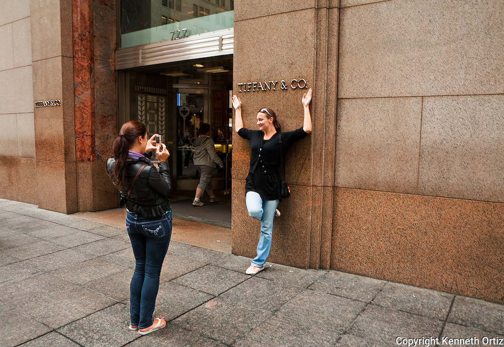 Women Photographing each other in front of Tiffany & Co. on 5th Avenue.