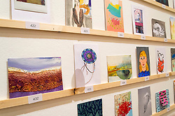 © Licensed to London News Pictures. 08/04/2016. Selection of postcards on display at The Royal College of Arts(RCA) 22nd annual Stewarts Law RCA Secret exhibition of postcards designed by well-known artists and designers. London, UK. Photo credit: Ray Tang/LNP