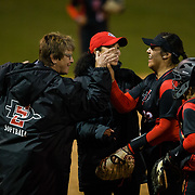 02 March 2018: San Diego State softball closes out day two of the San Diego Classic I at Aztec Softball Stadium with a night cap against CSU Northridge. San Diego State head coach Kathy Van Wyk congratulates starting pitcher/Marissa Moreno (33) after she pitched out of a bases loaded jam in the first inning against CSU Northridge. The Aztecs dropped a close game 2-0 to the Matadors. <br /> More game action at sdsuaztecphotos.com