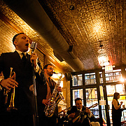 May 2, 2012 - Brooklyn, NY : Musician and composer Michael Arenella, second from left, performs with his jazz band at the Clover Club, which is located at 210 Smith Street in Brooklyn, on Wednesday night. CREDIT:  Karsten Moran for The New York Times