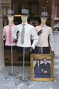 A shop display in London's Sloane Street uses a portrait of the British royal wedding couple as a wedding theme. 24 hours before their royal marriage in London, the faces of Prince William and his wife-to-be Kate Middleton are on a framed photograph among mannequins dressed in formal top hats and smart shirts and ties. Taking place on Friday 30th April in front of millions of Britons and foreign tourists (many American), the crowds are already gathering at  prime locations along the procession route.