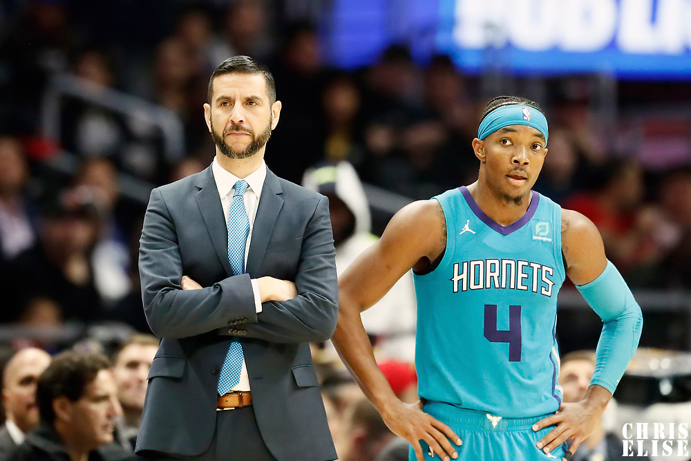 LOS ANGELES, CA - OCT 28: Charlotte Hornets head coach James Borrego is seen next to Devonte' Graham (4) of the Charlotte Hornets during a game on October 28, 2019 at the Staples Center, in Los Angeles, California.