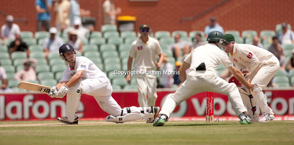 Jonathan Trott sweeps Xavier Doherty past close fielder Simon Katich during the second Ashes Test Match between Australia and England at the Adelaide Oval. Photo: Graham Morris (Tel: +44(0)20 8969 4192 Email: sales@cricketpix.com) 4/12/10