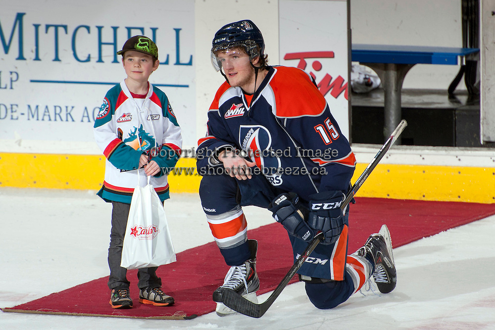 KELOWNA, CANADA -FEBRUARY 1: Collin Shirley LW #15 of the Kamloops Blazers accepts a star of the game against the Kelowna Rockets on February 1, 2014 at Prospera Place in Kelowna, British Columbia, Canada.   (Photo by Marissa Baecker/Getty Images)  *** Local Caption *** Collin Shirley;