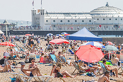 © Licensed to London News Pictures. 07/05/2018. Brighton, UK. Thousands of people take to the beach in Brighton and Hove on the May Bank Holiday Monday as warm weather continues to hit the seaside resort. This weekend has been the hottest May Bank Holiday weekend on record. Photo credit: Hugo Michiels/LNP