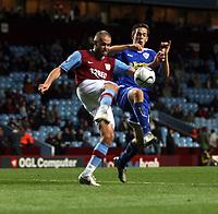Photo: Mark Stephenson.<br /> Aston Villa v Leicester City. Carling Cup. 26/09/2007.Villa's Olof Mellberg holdsa the ball up