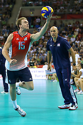 06.09.2014, Krakow Arena, Krakau, POL, FIVT WM, USA vs Frankreich, Gruppe D, im Bild Carson Clark (USA), Trener John Speraw (USA) // during the FIVB Volleyball Men's World Championships Pool B Match beween USA and France at the Krakow Arena in Krakau, Poland on 2014/09/06. EXPA Pictures &copy; 2014, PhotoCredit: EXPA/ Newspix/ Tomasz Jastrzebowski<br /> <br /> *****ATTENTION - for AUT, SLO, CRO, SRB, BIH, MAZ, TUR, SUI, SWE only*****