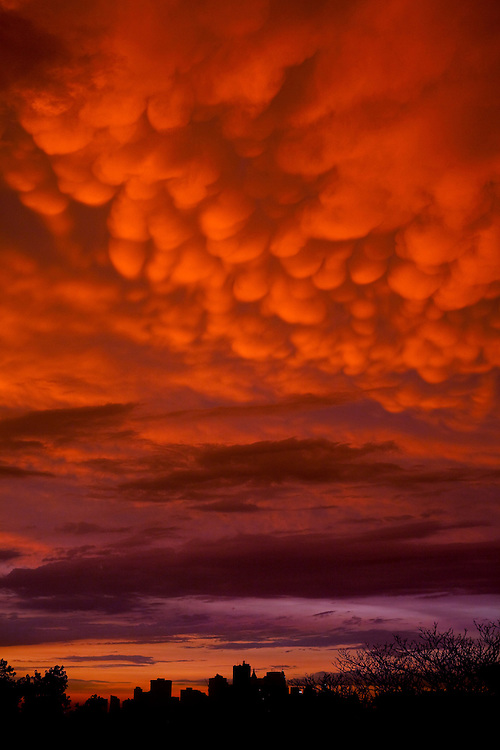 "These are rarely seen clouds in these parts. They are called ""Mammatus Clouds"" I believe because they are breast like in appearance. They are often seen before of after very stormy weather, and often after tornadoes."