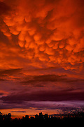 """These are rarely seen clouds in these parts. They are called """"Mammatus Clouds"""" I believe because they are breast like in appearance. They are often seen before of after very stormy weather, and often after tornadoes."""