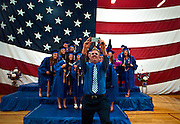 Science teacher Mark Walsh quickly jumps in front of the graduating seniors to take a selfie at the end of graduation ceremonies at Indian Springs High School on Thursday, June 4, 2015.  L.E. Baskow