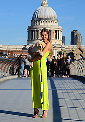 Amber Le Bon at the Canine Catwalk photocall. <br /> Amber Le Bon, launches Guide Dog Week 2013 with catwalk show featuring working guide dogs and blind models. Models wear clothes donated by ASOS.  Millennium Bridge, London, United Kingdom. Sunday, 6th October 2013. Picture by Nils Jorgensen / i-Images