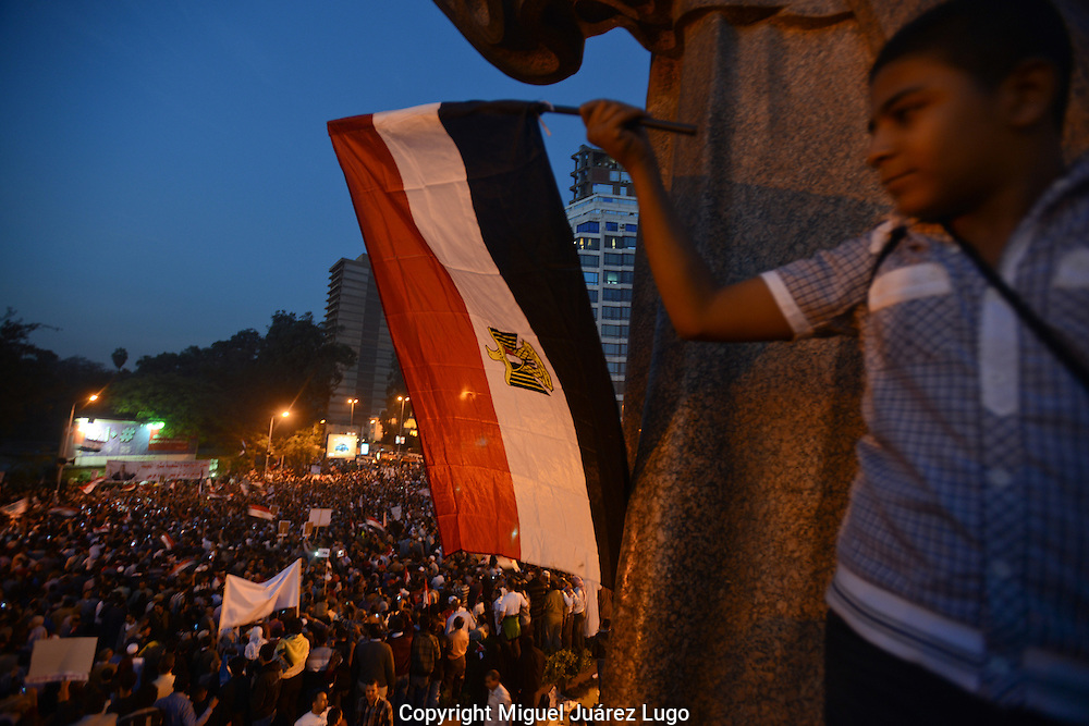 Cairo, Egypt, Dec 01, 2012 - A young boy holds a national flag in support of President Mohamed Morsi's contentious declaration giving himself near-absolute powers. The Muslim Brotherhood organized the massive rally at Egypt's Cairo University in the largest show of support for Morsi since his election this summer. Tens of thousands of Egyptians, mainly Islamists, came to support Morsi's sweeping new powers and a controversial draft constitution. (Photo by Miguel Juarez Lugo)