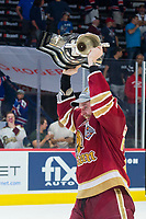 REGINA, SK - MAY 27:  Olivier Galipeau #26 of Acadie-Bathurst Titan raises the Memorial Cup trophy over his head after the win against the Regina Pats at Brandt Centre - Evraz Place on May 27, 2018 in Regina, Canada. (Photo by Marissa Baecker/CHL Images)