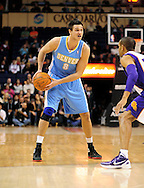 Dec. 22, 2011; Phoenix, AZ, USA; Denver Nuggets forward Danilo Gallinari (8) reacts on the court against the Phoenix Suns at a preseason game at the US Airways Center. Mandatory Credit: Jennifer Stewart-US PRESSWIRE.