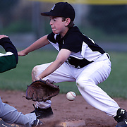 A play at second base as the runner slides in during the Norwalk Little League baseball competition at Broad River Fields, Norwalk, Connecticut. USA. Photo Tim Clayton