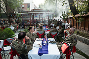 KABUL, AFGHANISTAN - SEPTEMBER 4: American service members deployed for Mission Resolute Support (RS) eat dinner at a barbecue celebrating Labor Day at RS Headquarters on September 4, 2017 in Kabul, Afghanistan. Currently the United States has about 11,000 troops in the deployed in Afghanistan, with a reported 4,000 more expected to arrive in the coming weeks. Last month, President Donald Trump announced his plan for Afghanistan which called for an increase in troop numbers and a new conditions-based approach to the war, getting rid of a timetable for the withdrawal of American forces in the country. (Photo by Andrew Renneisen/Getty Images)