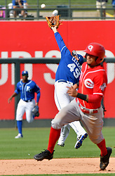 March 20, 2017 - Surprise, AZ, USA - Kansas City Royals third baseman Garin Cecchini couldn't reach a soft RBI pop up over his glove hit by Cincinnati Reds' Hernan Iribarren in the eighth inning on Monday, March 20, 2017 during a spring training baseball game in Surprise, Ariz. (Credit Image: © John Sleezer/TNS via ZUMA Wire)