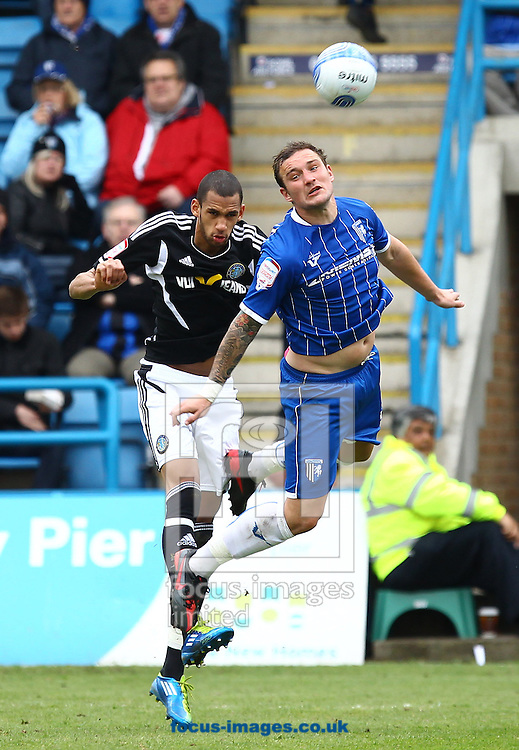 Picture by John Rainford/Focus Images Ltd. 07506 538356.31/03/12.Danny Kedwell of Gillingham and Tony Diagne of Macclesfield during the Npower League 2 match at Preiestfield Stadium, Gillingham.