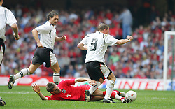 CARDIFF, WALES - SATURDAY MARCH 26th 2005: Wales' Sam Ricketts tackles Austria's Christian Mayrleb during the Wold Cup Qualifying match at the Millennium Stadium. (Pic by David Rawcliffe/Propaganda)