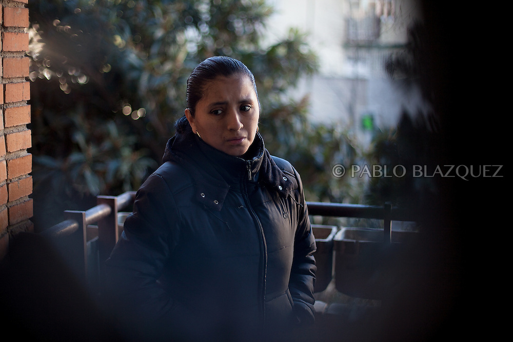 Patricia Tapia, 28, looks on while she waits to be evicted from her apartment on February 15, 2012 in Madrid, Spain. Tapia, an unemployed Ecuadorian mother of two, used to work at a mailing company but when she was six months pregnant the employer decided not to renew her contract and she could not afford to pay her mortgage. The anti-eviction organization 'Platform for People Affected by Mortgages' in Spain has called for a permanent halt to the evictions of families who are struggling to pay their debts because of the poor economic climate.