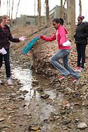 Girl Scouts cross a stream while on a mini-hike during Program Aide (PA) training at the Girl Scouts Urban Campus in Dayton, Saturday, March 3, 2012.