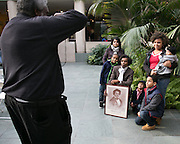 Guests pose with Frederick Douglass, portrayed by Carlos Merriweather of Rochester, at Black History Month Family Day at the Memorial Art Gallery on Sunday, February 22, 2015.