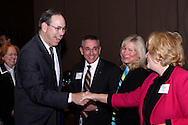 Deborah Gross of D. Gross Consulting LLC (right) greets Bob Taft, former Ohio governor and DACC public policy oversight chair, during the Dayton Area Chamber of Commerce Government Affairs Breakfast at the Crowne Plaza Hotel in downtown Dayton, Wednesday, November 30, 2011.
