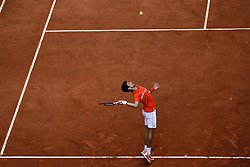 May 30, 2019 - Paris, France - Serbia's Novak Djokovic serves the ball to Switzerland's Henri Laaksonen during their men's singles second round match on day five of The Roland Garros 2019 French Open tennis tournament in Paris on May 30, 2019. (Credit Image: © Ibrahim Ezzat/NurPhoto via ZUMA Press)
