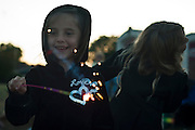 Lathan Goumas for the Midland Daily News..Isabella Bainbridge, 5, of Auburn, plays with a sparkler while waiting for the start of the final day of the 50th Bay City Fireworks Festival on Saturday, July 7, 2012 in Bay City, Mich. In celebration the festival planned to fire off 50,000 fireworks in 50 minutes on the final day of the three day event.
