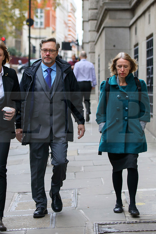 """© Licensed to London News Pictures. 17/11/2016. London, UK. Parents of Jack Letts, dubbed """"Jihadi Jack"""", John Letts (L) and Sally Lane (R) arrive at The Central Criminal Court for a plea hearing for attempting to provide money knowing it may be used to fund terrorism on 17 November 2016. Photo credit: Tolga Akmen/LNP"""