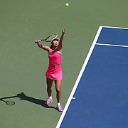 Shuai Peng, China, in action against Elina Svitolina, Ukraine, during the first round of the Connecticut Open at the Connecticut Tennis Center at Yale, New Haven, Connecticut, USA. 18th August 2014. Photo Tim Clayton