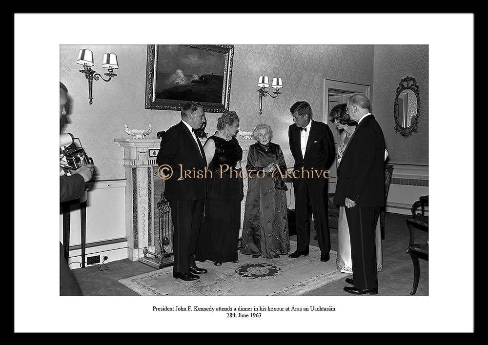 President John F. Kennedy attends a dinner in his honour at Áras an Uachtaráin.<br />