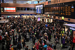 © Licensed to London News Pictures. 23/12/2016. London, UK.  Crowds of holiday markers and commuters look up at the departure boards at Euston Station in London, as the Christmas getaway begins, with stations, airports and roads expected to be very busy as people start their Christmas holidays. Photo credit: Ben Cawthra/LNP