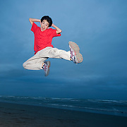 Asian teenage boy jumping in air  MR.
