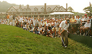 Phil Mickelson (R) of the US chips onto the 18th green at the end of the third round of the 2005 PGA Championship at Baltusrol Golf Club in Springfield, New Jersey, Saturday 13 August 2005. Mickelson and Davis Love III are now tied for  the lead in the compeition, each shooting 6 strokes under par. In the background is the Baltusrol clubhouse.